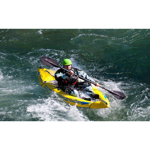 Yellow Advanced Elements Attack Whitewater 1 Person Inflatable Kayak coming off a wave with a single paddler.