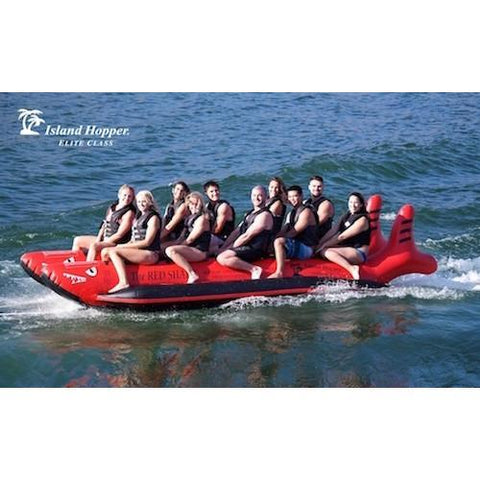 Island Hopper 10 Person Red Shark Banana Boat side view of the banana boat riding across the lake.