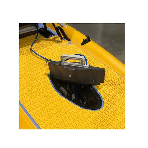 Bixpy Fin Pedal Drive Adapter for Kayaks partially inserted into opening in the yellow kayak floor.