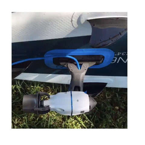 Bixpy Outboard Kayak Motor being used with the Bixpy Adapter for Inflatables.  The Bixpy Kayak Jet Motor is attached to the bottom of inflatable kayak.  The grey body of the Bixpy Jet is connected to the inflatable kayak with a royal blue sealed attachment.