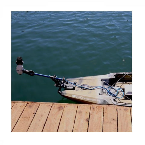 Bixpy Universal Power Pole Kayak Adapter  is shown hinged out of the water while docked.  Only the back portion of the kayak is visible.