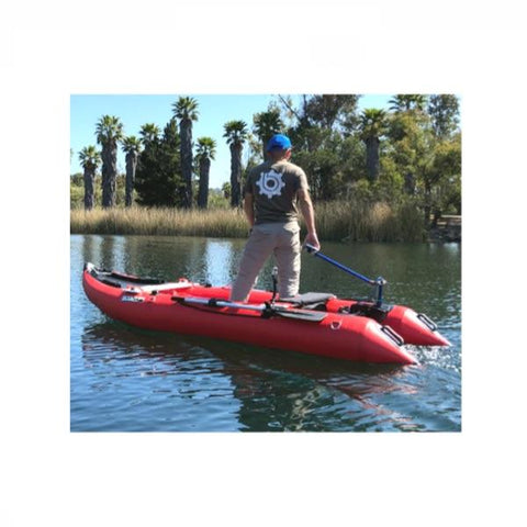 Bixpy Universal Transom Adapter is shown to be easy to use in this image of a man standing up and steering his inflatable boat with the Bixpy Transom Adapter.  View is from the side of the boat, which is in the water.