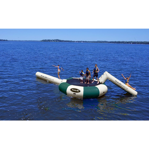Several kids on a green and tan Rave Bongo 13 Water Bouncer Water Park Northwoods edition on the lake. Tan Aqua Slide and tan Aqua Log attached.