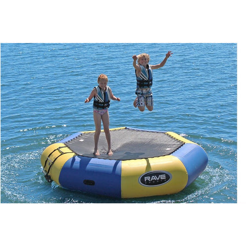 2 kids bouncing on a blue and yellow Rave Bongo 10 Water Bouncer on the lake.