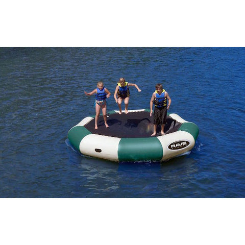 3 kids playing on a tan and green Rave Bongo 13 Water Bouncer Northwoods edition on the lake.
