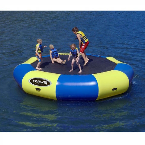Yellow and blue Rave Bongo 15 Water Bouncer on the lake with 5 young kids playing on the black bounce surface.