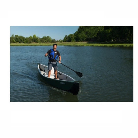 Man standing and paddling in a Sea Eagle Inflatable Canoe 16