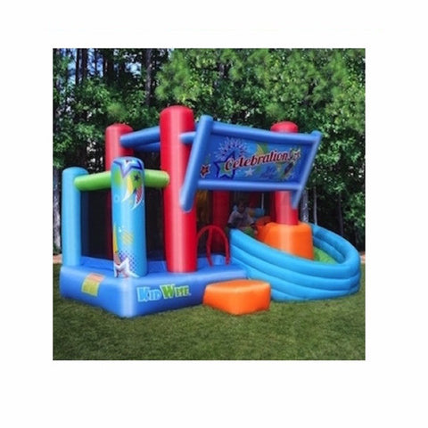 KidWise Celebration Bounce House and Tower Slide | Side view of the KidWise Bouncer outdoors in the backyard.  The KidWise Bounce house is predominantly Royal blue, light blue, and red with some green and orange accents.  KidWise Bouncer banner over the bounce house curved slide.