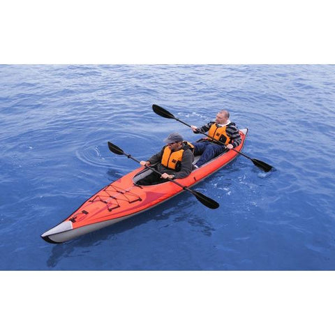 Top view of the Red Advanced Elements AdvancedFrame Convertible Inflatable Kayak with 2 paddlers out on the water.