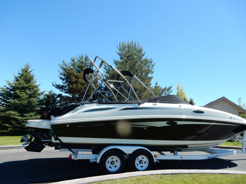 Side view of the Barefoot Fly High Pro X Series Crossbar Tower on ski boat on a trailer.