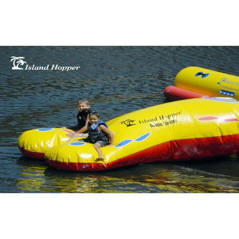 Front right view of Island Hopper Double Blaster Water Trampoline Attachment on the lake.