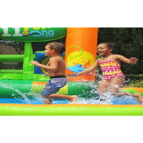 KidWise Endless Fun 11 in 1 Inflatable Bounce House and Water Slide.  Boy and girl playing in the splash pool.