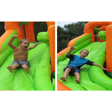 KidWise Endless Fun 11 in 1 Inflatable Bounce House and Water Slide 2 pictures of young boys sliding down the green slide.
