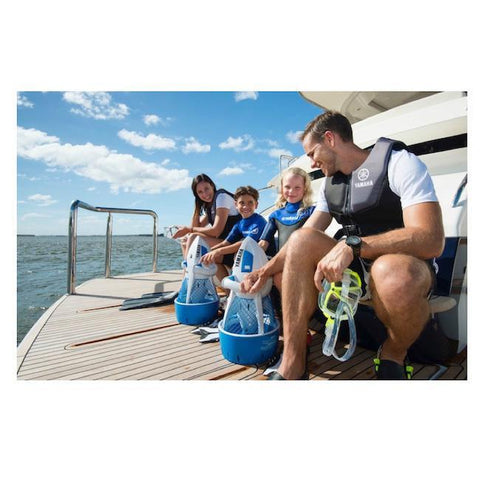 A family on the back of a boat about to usse their Yamaha Explorer Seascooters out on the ocean.