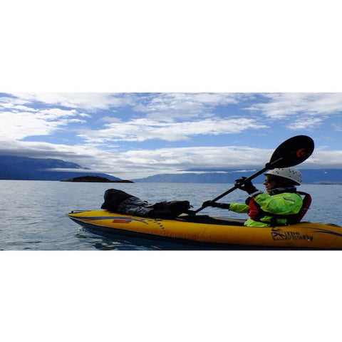 1 Person paddling the Advanced Elements FireFly Inflatable Kayak out in the ocean.