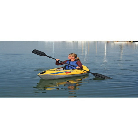 Yellow Advanced Elements FireFly Inflatable Kayak - 1 Person paddling on the water.