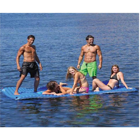 Airhead Gang Plank Inflatable Water Mat 6x10 in the middle of the lake with 6 people enjoying the floating water mat.