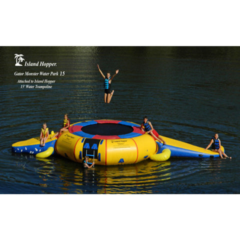 5 kids playing on the Island Hopper 15' Gator Monster Water Trampoline Water Park sitting on the lake.