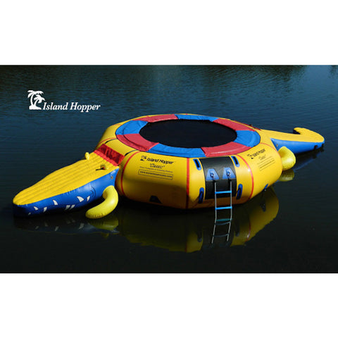Top/Side view of Island Hopper 15' Gator Monster Water Trampoline Water Park sitting unoccupied on a calm lake.  Yellow inner tube with blue and red trim and black water trampoline surface.