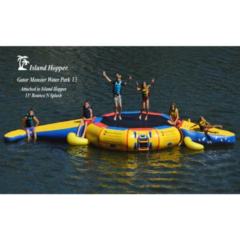 Kids playing on the Island Hopper 13ft Gator Monster Water Bouncer Water Park in the lake.  Side view.