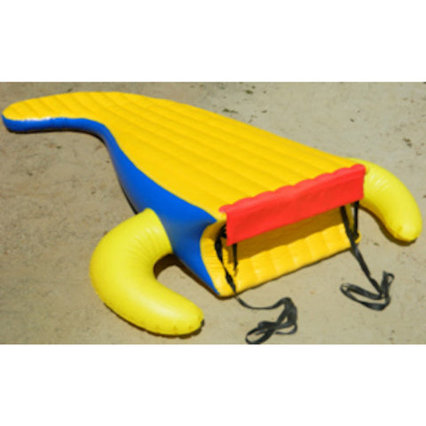 Detached tail slide for the Island Hopper 13ft Gator Monster Water Bouncer Water Park sitting on the beach.