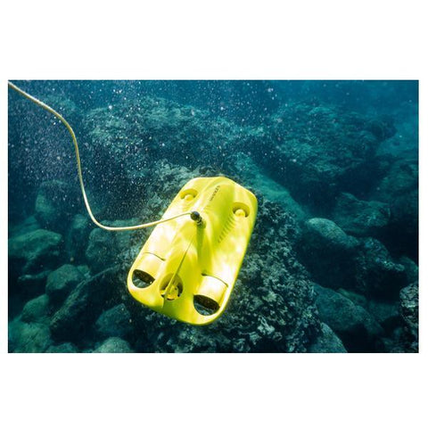 Top view of a Chasing Gladius Mini Underwater Drone sitting on a reef.  The yellow underwater drone for sale and the yellow tether are clearly visible in the crystal clear water.