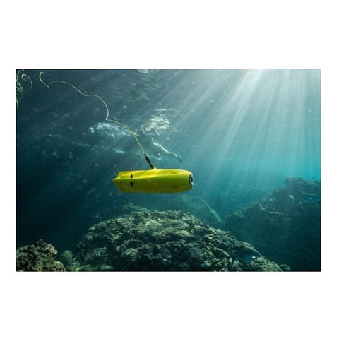 Underwater close up side view of the Chasing Gladius Mini Underwater Drone.  It is yellow and there are air bubbles coming out of the side from the propellers.  Clear water with the sun shining thru make the Gladius ROV sparkle.