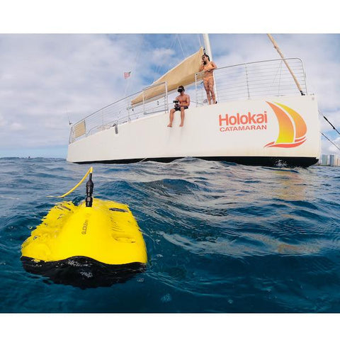 Chasing Gladius Mini Underwater Drone is on the surface of the water being controlled by a man on a boat on the ocean.  The underwater drone for sale is ready to break the surface and explore.