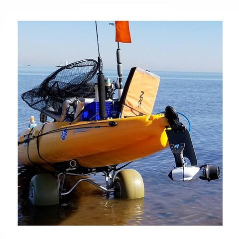 View of the back of an orange Hobie kayak on a 2 wheel cart about to go into the ocean.  The Bixpy Hobie Twist & Stow Kayak Rudder Adapter is attached on the back.