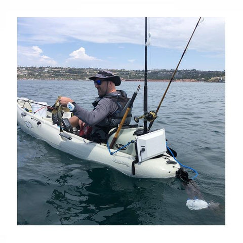 Out in a fishing kayak with the Bixpy Hobie Twist & Stow Kayak Rudder Adapter shown attached on the back of the white kayak in the water just below the surface with the Kayak Jet Motor attached.