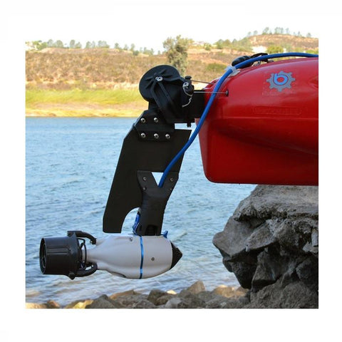 Bixpy Hobie Twist & Stow Kayak Rudder Adapter attached to the back of a red kayak near the water.