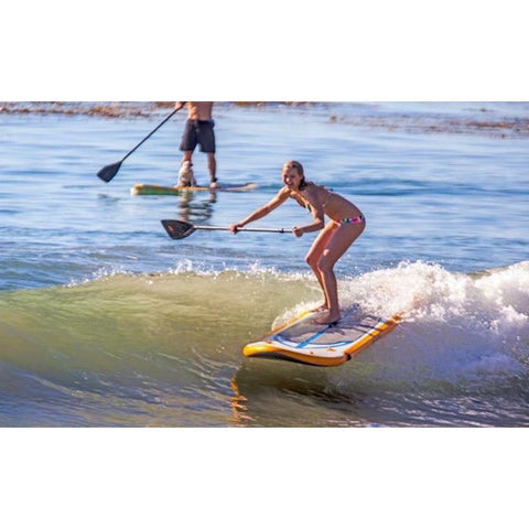 Advanced Elements Hula 8 Inflatable Stand Up Paddle Board (SUP) catching a wave.