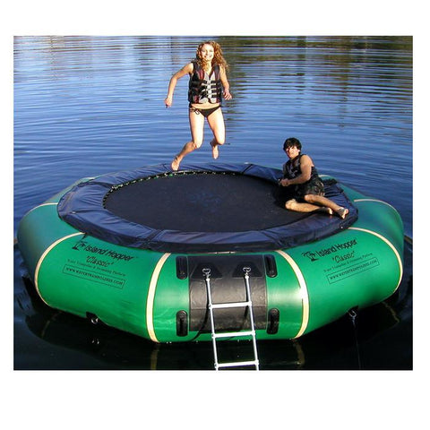 The Natural Green Island Hopper Classic Water Trampoline is shown here.  The tube is Natural Green and the pad and jump surface are both black.  There are white seam reinforcements around the water trampoline.  Here it is shown with a girl jumping and a boy laying down on the Island Hopper Water Trampoline.