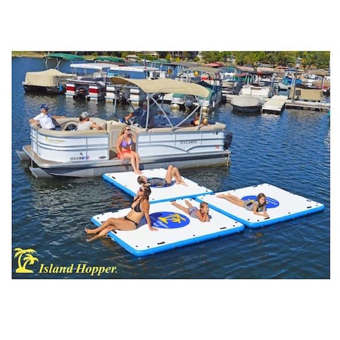 3 Island Hopper Island Buddy Floating Swim Platforms are hooked together in a T shape coming off of a pontoon boat.  The Island Hopper floating swim platforms are white with a blue logo with yellow lettering that reads Island Hopper Island Buddy Floating Swim Platform.  The border of the square floating swim platform is light blue.