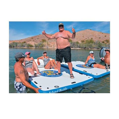Island Hopper Island Buddy Floating Swim Platforms hooked together in a lake.  1 large man is standing on the inflatable swim dock while 2 others are laying on it.  There are also 2 people on the second Island Hopper Floating Swim Platform.
