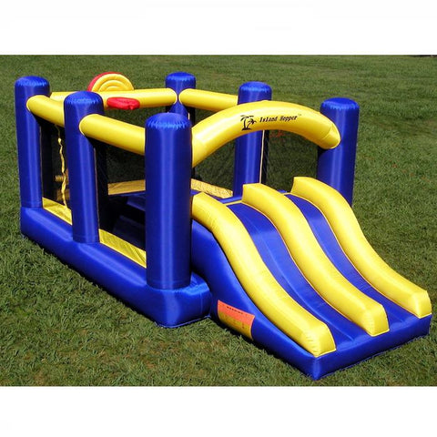 Island Hopper Racing Slide and Slam Bounce House Top Front Left Side view outside on the lawn.  Blue and Yellow design with duel slides, basketball goal, and bounce house visible.