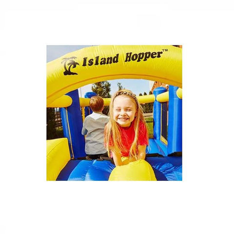 Island Hopper Racing Slide and Slam Bounce House girl and boy playing in the bounce house