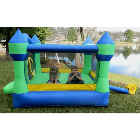 2 kids playing in the Island Hopper Jump Party Bounce House out in the backyard.