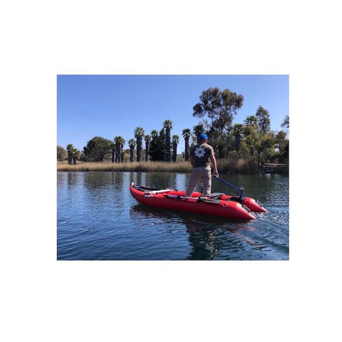 Bixpy Kayak Jet Motor is shown using the kayak outboard motor power pack connection and the Bixpy Universal Transom Adapter on a red inflatable pontoon boat.