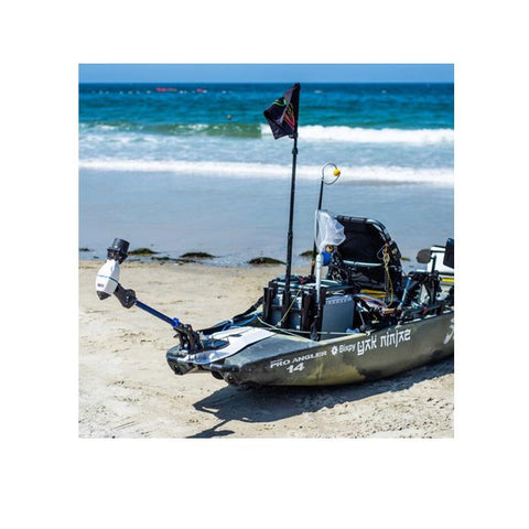 A kayak sits on the beach just outside the ocean waves running up the beach.  The Bixpy Kayak Jet Motor Outboard Kayak Motor Kit is shown on the rear of a kayak using a Bixpy Power Pole Adapter.  The Bixpy Jet Thruster is at the end of the fully extended pro angler kayak adapter and up in the air.