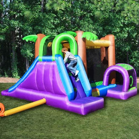 KidWise Monkey Explorer Jumper outdoors, showing the purple climbing wall and slide side of the recreational bounce house.