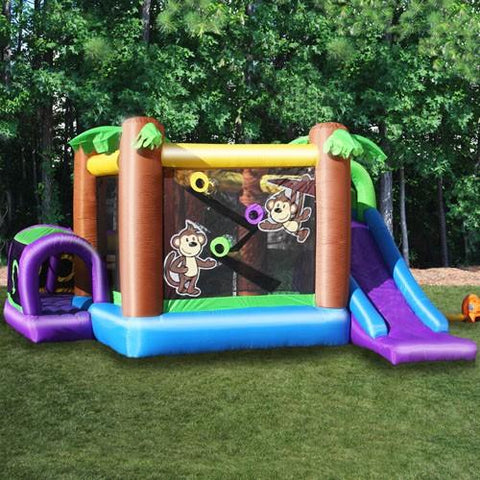 Side view of the KidWise Monkey Explorer Jumper in the backyard. You can see the front of the slide and the entry into the wrap around crawl tunnel.