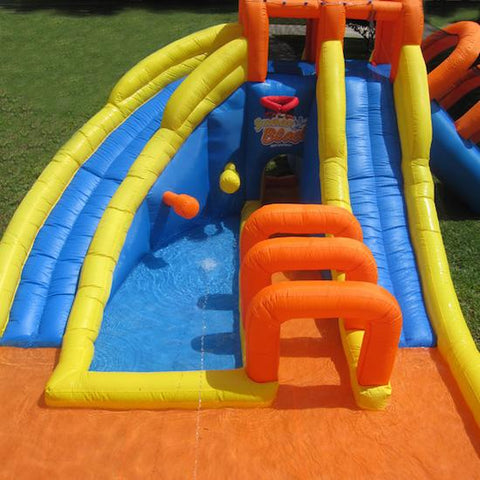 Front view of the KidWise Summer Blast Waterpark, showcasing slides, slippery tunnel, splash pools and basketball goal