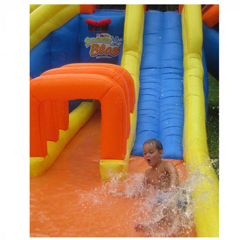 Kid sliding in to the splashy zone of the KidWise Summer Blast Waterpark