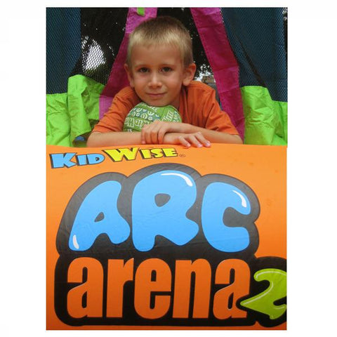 KidWise Arc Arena 2 Sports Bounce House with a kid laying out the entry area with a soccer ball under his chin.