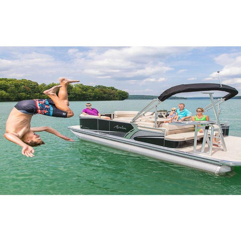 A teenager does a flip off of the Lillipad Diving Board - Pontoon Diving Board Surface Mount out on the lake, mounted on a pontoon boat. Also known as Lily Pad Diving Board