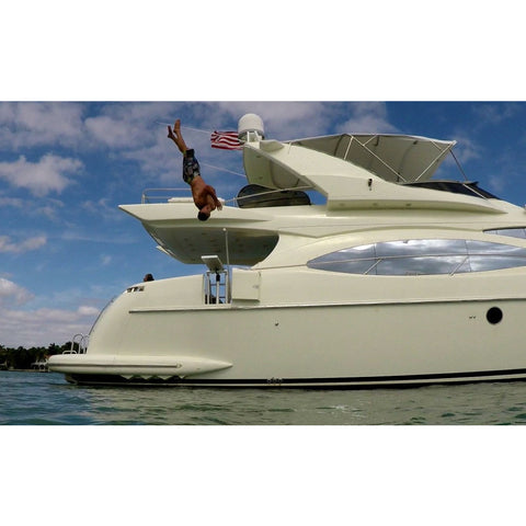 Jumping off of a Lillipad Boat Diving Board on a yacht.   Also known as Lily Pad Diving Board