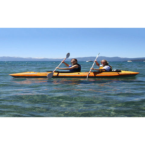 Advanced Elements Lagoon 2 Person Inflatable Kayak side view of 2 passengers in the recreational inflatable kayak on the lake.
