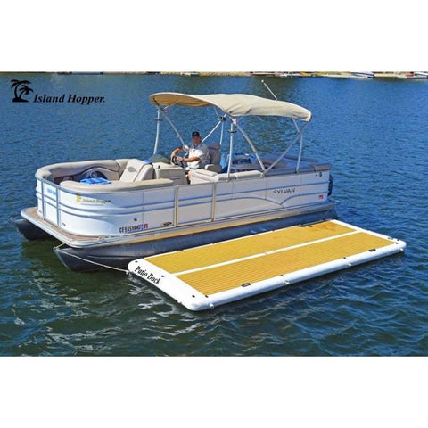The Island Hopper Patio Dock Floating Swim Platform is shown attached to a pontoon with nobody on it so that you can fully see the EVA foam non-slip surface which is tan in color as well as the white inflatable dock border.