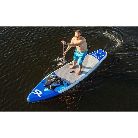 Overhead view of a man paddling a Rave Nomad 6 Inflatable SUP across the lake.  Life jacket strapped into the front storage straps on the blue inflatable SUP.